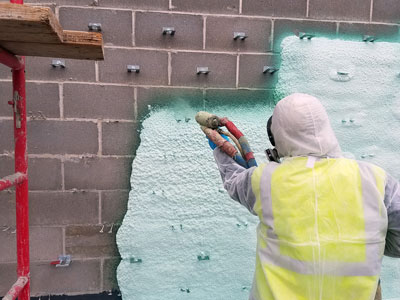 insulation contractor spraying foam with various spray types